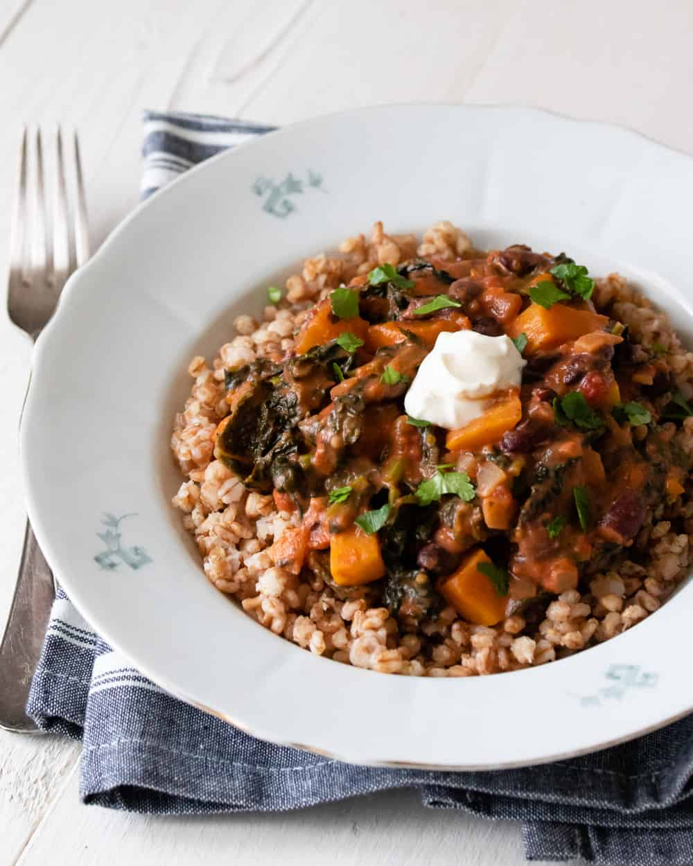Bowl of pearled wheat with tomato sauce and winter vegetables.