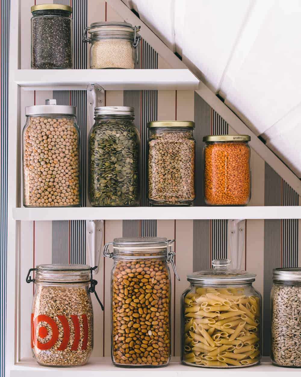 Jars of pantry items on a shelf.